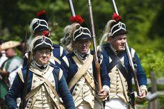 Marching at Redcoats & Rebels Revolutionary War re-enactment at Old Sturbridge Village.