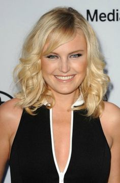 Adding oomph to hair balances the roundness of your face, says Palacios. Malin Akerman's collarbone-length hair is just short enough to keep cool in the sweltering summer months.   - Redbook.com