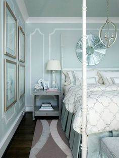 Serene bedroom colors.  The white trim, the painted ceiling, the dark floors look amazing together.  And I adore the bedding.