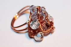SOLD  free form wire wrapped ring, with Czech glass beads and crystals. size 6.  http://www.artfire.com/ext/shop/product_view/amijusARTdesign/5006787/_crystal_cave_of_holy_land_/handmade/jewelry/rings/wirewrapped