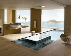 Spa bath that leads to ocean view outdoors.
