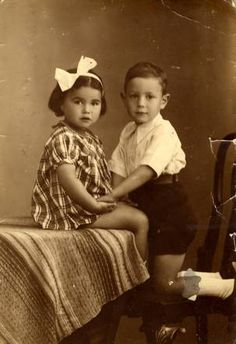 Anna Vleeschhouwer (sitting) Anna was sadly murdered in Auschwitz on September 3, 1943 at age 7. Anna was from Amsterdam, Netherlands.