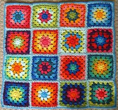 I hope to someday perfect my crochet enough to make one of these. LOVE the bright multi-colors!