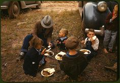 *Homesteader and his children eating barbeque at the New Mexico Fair. Pie Town, New Mexico, October 1940. Reproduction from color slide. Photo by Russell Lee. Prints and Photographs Division, Library of Congress