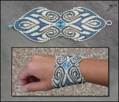 """(2010), 3"""" x 9"""", size 15 seed beads (bone white, transparent honey, silver-lined aqua, silver lined lavender), blue silver-lined square glass beads, blue faceted chalcedony beads, nylon thread. It'..."""