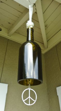 Recycled Wine Bottle Wind Chime with Peace Symbol and Chainmaille. $26.00, via Etsy.