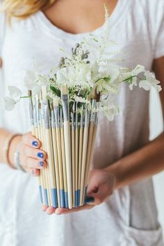 Paintapalooza Wedding Ideas. Love the paint brush vase.  That would be cute at home!