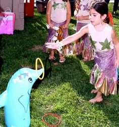 This dolphin ring toss would be a fun game at themed party,  Go To www.likegossip.com to get more Gossip News!