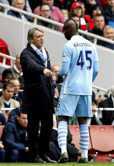 Roberto Mancini, ManCity Boss, and Super Mario Balotelli, forward. Balotelli will come on the court for the big match against #reddevils (ManUtd)
