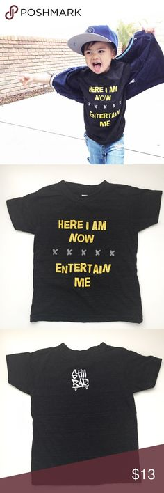 "Entertain Me Tee Soft dark gray tri-blend unisex shirt with ""Here I Am Now Entertain Me"" with Still Rad on the back. Such a fun shirt that really speaks the truth about kids! Excellent condition **slip-on style shoes and yellow shorts are also for sale in my closet** // No trades. Ships daily Mon to Fri. Add to Bundle items for a discount. Xo, Instagram @dasrozo for mommy and me fashion + fam adventures. Shirts & Tops Tees - Short Sleeve"