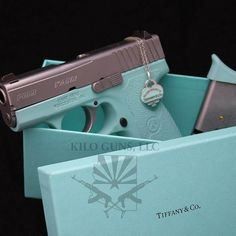 "Kahr Arms handgun finished in ""Tiffany blue"" laying in a box from Tiffany and Co."