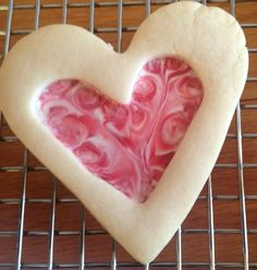 Stain Glass Heart Shaped Sugar Cookies ~ I used Campino Strawberries & Cream Candies instead of Jolly Ranchers to get this pretty pink and white swirl effect.