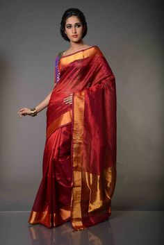 Alankritha Plain Bodied Metallic Maroon Mangalgiri Silk Cotton Saree : An unadorned zari border, characteristic of the Nizam borders in Mangaliri Sarees and a dash of golden zari thrown in the pallu, this all shimmering plain bodied Mangalgiri Silk Cotton Sari that is woven with silk in warp and cotton in weft, is the endowment of Mangalgiri Sarees. As Mangalgiri Handlooms are known to be woven on a pit-loom, this saree is a preferred choice for showcasing comfort in style.
