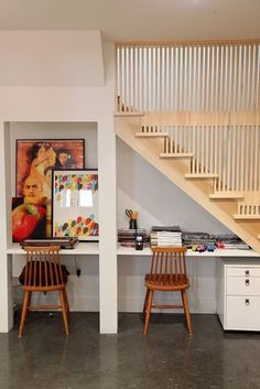 Make use of that awkward, cramped space under the stairs with a tiny built-in. Your workspace can double as a great hiding spot.