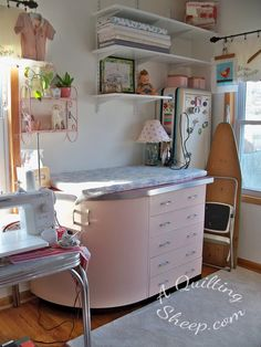 A Quilting Sheep: New Sewing Room...cute room; uses vintage pillowcases, etc for curtains