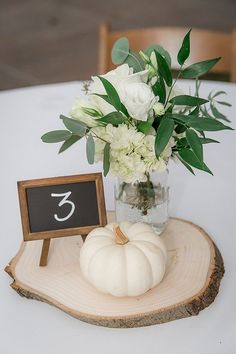 DIY & easy to make fall wedding table centerpiece! With rustic style, cute pumkins & fall colors Cute rustic fall wedding centerpieces with mini chalkboards and white pumpkins wedding hair Pretty in Pink Outdoor Wedding on the Chesapeake Bay Rustic Wedding Centerpieces, Wedding Table Centerpieces, Centerpiece Flowers, Wedding Rustic, Centerpiece Ideas, Elegant Wedding, Trendy Wedding, Fall Wedding Table Decor, Romantic Weddings