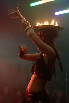 tribal fusion bellydance with tea candle tray balance Lumiere Photo, Breathing Fire, Estilo Tribal, Deep Books, Fire Dancer, Tribal Belly Dance, Tribal Fusion, Belly Dance Costumes, Lets Dance