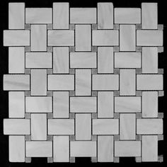 (http://www.carraratiles.com/carrara-marble-italian-white-bianco-carrera-basketweave-mosaic-tile-with-bardiglio-gray-dots-honed.html)