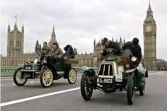 The London to Brighton Vintage car race. A troubled 1904 Lacoste et Battmann veteran car, right, is passed by a 1904 Cadillac on Westminster Bridge in London during the London to Brighton veteran car run. Held annually since 1930