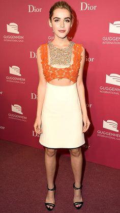 Kiernan Shipka in a cream, orange and gold cutout Dior Haute Couture dress