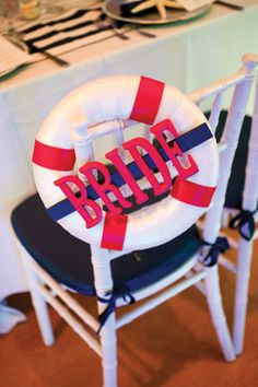 Nautical bride chair back. Photo by Captured Photography by Jenny