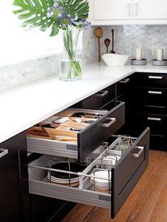 Kitchen, white counters, drawer storage, ceramic wood like tile