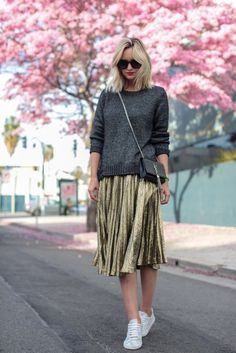 How to style a pleated skirt and dazzle the world in gold metallic pleated skirt and white sneakers on the street style.