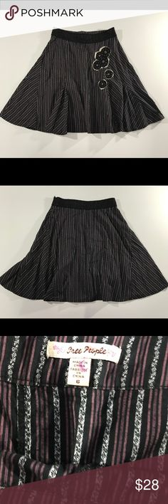 "❄️50% off Free People Stripe A Line Skirt sz 6 Black & purple stripes with lace & bead appliqué flowers. Please note- on one of the flowers there is a stitch that is loose and a dark spot on the cream lace- please see up close photo. 97% cotton, 3% spandex. Zipper on left hip. Flat across waist approx 15.5"", length approx 23"" Free People Skirts A-Line or Full"