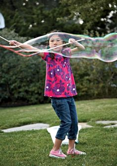 make giant bubbles  tutorial also one to make from one dowel here http://people.uvawise.edu/netsacs/Documents/ncw/2005/Make%20Your%20Own%20Giant%20Bubble%20Wand.pdf