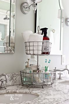 Great idea to stay organized in the bathroom!  2 tiered wire basket stand for bathroom organization-www.goldenboysandme.com