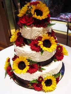 Sunflower wedding cake for Sunflower Wedding with accents of red asters/