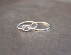 This set includes two thin pinky stacking rings. Order them in sterling silver, fine silver, or copper.  https://ravingruby.com/product/pinky-rings/