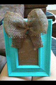 $3 black frame painted turquoise with a burlap bow! So easy and faBOWlous