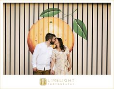 holding hands, outdoors, yellow, vintage, outdoor, international diamond center, engagement, engagement session, limelight photography, step into the limelight, boardwalk, pier, water, hugging, kissing, palm trees, ring, details, wedding, peach