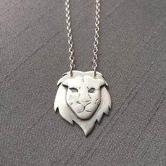 """For the lion lovers! This one-of-a- kind piece, is hand formed and etched in fine silver (.999%) and hangs on an 18"""" sterling silver chain. ($65)"""