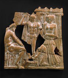 Terracotta plaque, c. 450 B.C., Greek, Melian, Classical era.  Eurykleia washing Odysseus's feet.  Metropolitan Museum of Art, New York