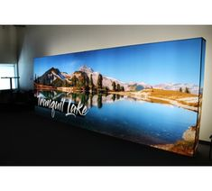 NEW 20' NEXT! Backlit SEG Fabric Pop Up Display Booth Wall. This modern portable light box display features one single seamless 8' x 20' #trifab backlit fabric mural graphic. Unlike other #backlitpopups , NEXT!  is the only portable SEG light box pop up booth system that connects two 10' frames without a center stitched graphic seam. In addition to it's one of kind 20ft long illuminated dye sublimation SEG panel, NEXT! hybrid modular pop up hardware allows resizing down to a 10'…