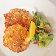 Corn fritters made with coconut flour. Top with avocado, cucumber and tomato salad #glutenfree The Healthy Journey