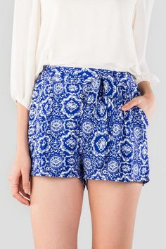 """The Elling Printed Tie Shorts are perfect for a tropical getaway! A blue porcelain print graces these soft shorts finished with a tie around the waist.<br /> <br /> - 12.5"""" length<br /> - 27"""" waist<br /> - 2"""" inseam<br /> - measured from a size small<br /> <br /> - 100% Polyester<br /> - Machine Wash<br /> - Imported"""
