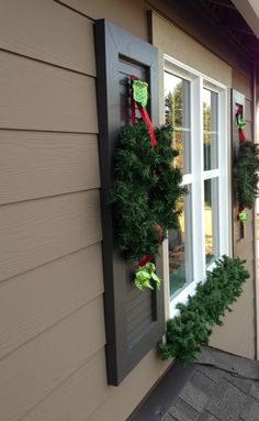 love this look....wreaths on the shutters and garland beneath