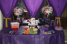Cake table, plastic table clothes are used to look like curtains.