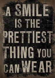 Tekstbord Linnen A Smile is...
