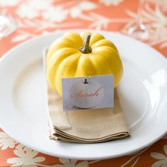 Flag your guests down for dinner with personalized place cards made from business-card-size paper pinned on a mini-pumpkin.