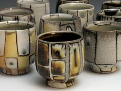 Lorna Meaden, lots of small soda fired cups with mishima technique