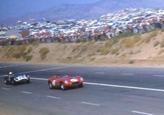 Phil Hill -- Ferrari 412 MI / Chuck Daigh -- Scarab-Chevrolet Hill leads Daigh during their epic battle for the lead early in the 1958 L.A. Times GP.  Shot on the high-speed main straight, this photo shows both cars nose-up; either under acceleration or from aerodynamic lift in this pre-spoiler era.