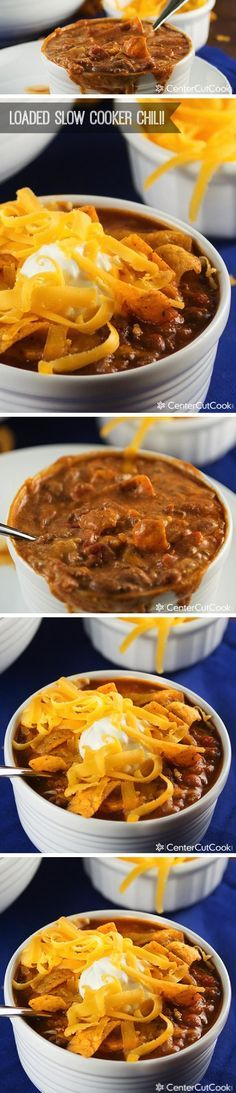 An easy SLOW COOKER CHILI recipe that develops incredible flavor as it's slow cooked in the crock pot all day long! Topped with sour cream, cheese and Fritos, this is a recipe everybody is going to love!