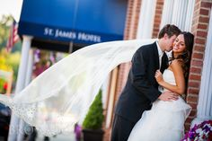 Wedding photo outside of the St. James Hotel in Red Wing, Minnesota Photo by Brovado Weddings