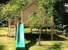 This play area with slide and decking provides 360 views of the garden.