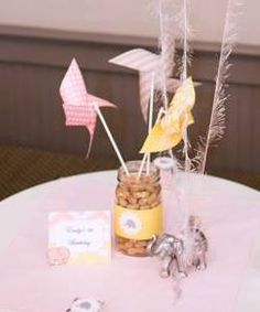 Emily's 1st Birthday Party - Pink Gray Yellow, Elephant Theme - Picture #3: Centerpieces - pinwheels, peanuts, elephants