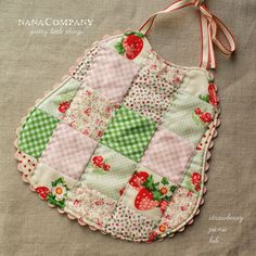 handmade strawberry patchwork baby bib - This would be so cute made out of your mother's or grandmother's aprons for your baby.